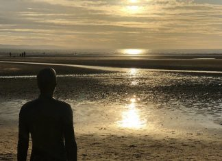scouse bird crosby village iron men anthohng gormley crosby beach